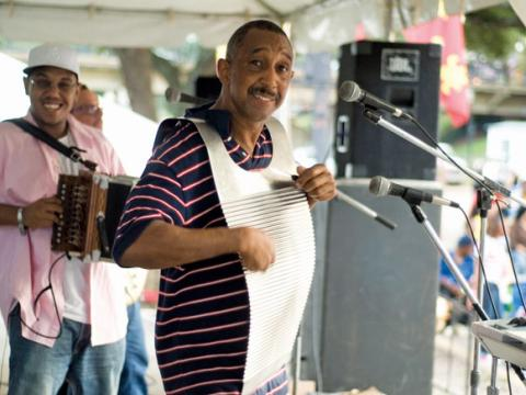 Playing the washboard at the Cane River Zydeco Festival