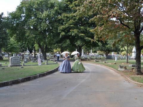 Costumed historic characters at the Maple Hill Cemetery Stroll in Huntsville, Alabama
